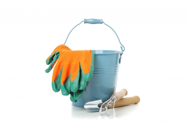 Bucket, gloves and gardening tools isolated on white