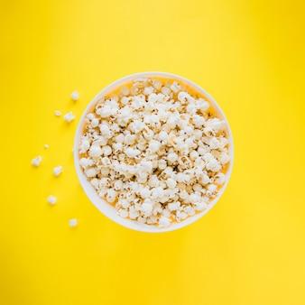 Bucket of popcorn on yellow