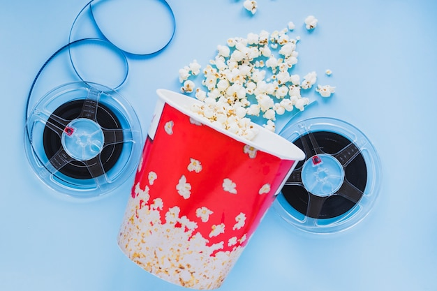 Bucket of popcorn with film reels