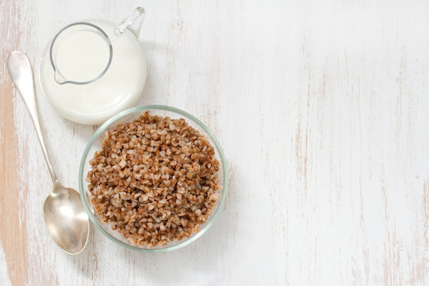 Buckwheat in bowl with milk