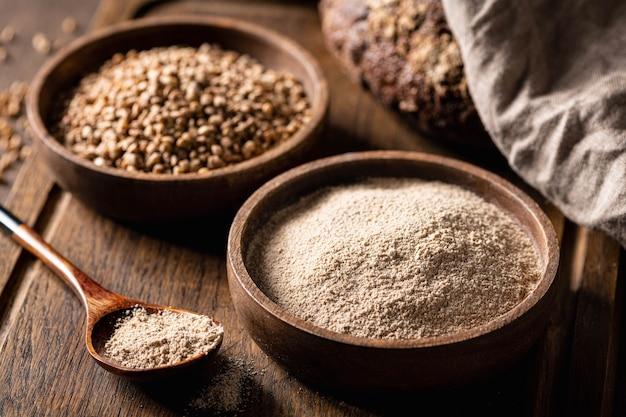 Buckwheat and buckwheat flour on a wooden kitchen board glutenfree