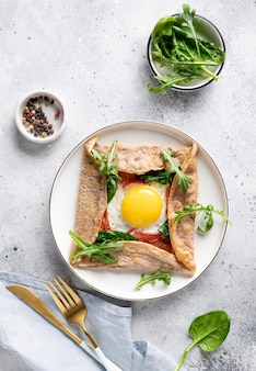 Buckwheat crepe galette with egg, ham and spinach. traditional french dish