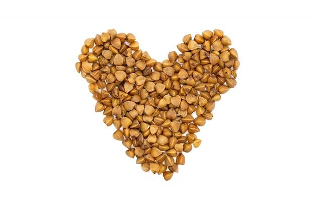 Buckwheat groats, heart-shaped, close up, isolated.