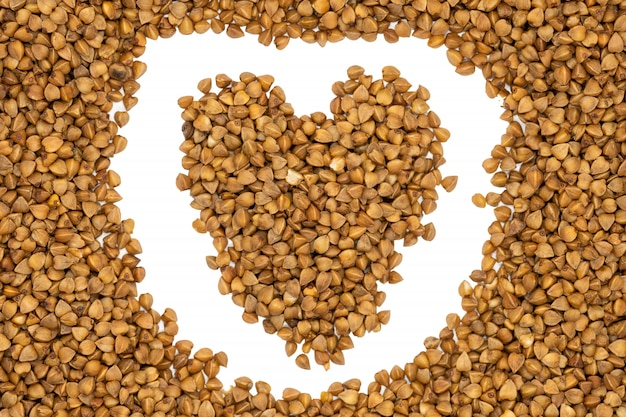 Buckwheat groats, heart-shaped, close up.