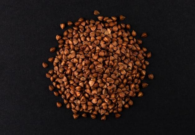 Buckwheat groats isolated on black