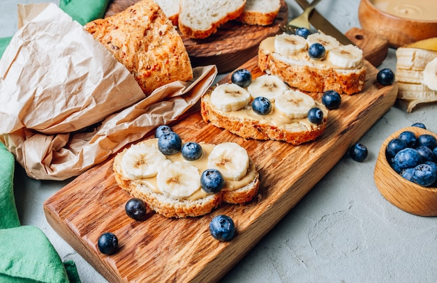 Buckwheat healthy bread with peanut butter, banana and blueberry