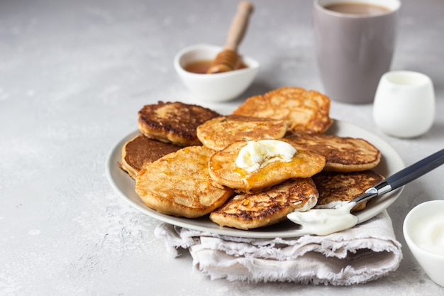 Buckwheat pancakes with honey and sour cream
