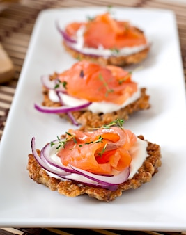 Buckwheat pancakes with salted salmon and sour cream