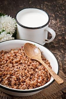 Buckwheat porridge in an old ceramic bowl on a rustic style