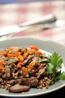 Buckwheat porridge with stewed meat and carrots