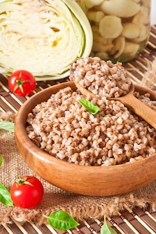 Buckwheat porridge in a wooden bowl