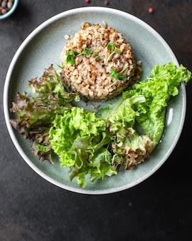 Buckwheat and salad fresh green mix salad lettuce keto or paleo diet vegan or vegetarian food
