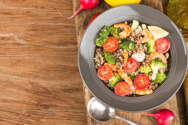 Buckwheat salad with broccoli chicken breast shrimp, three-color quinoa salad. superfood and healthy eating concept.