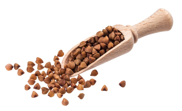 Buckwheat in wooden scoop isolated on white