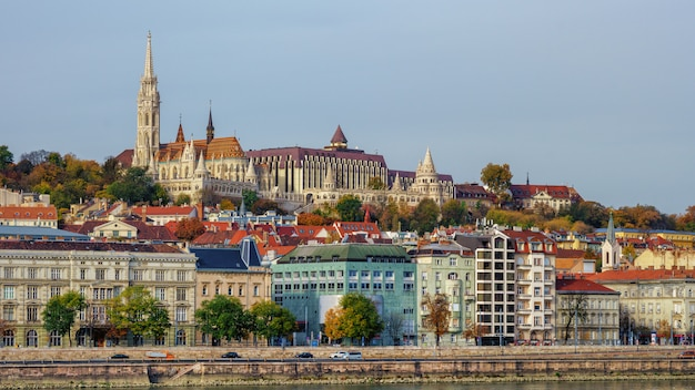 Buda castle over colorful buildings and danube river embankment, budapest