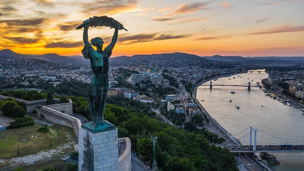 Budapest, hungary, july 2019 - aerial view liberty statue in budapest during dusk