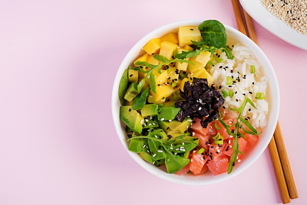 Buddha bowl with rice, mango, avocado and salmon. healthy food concept.