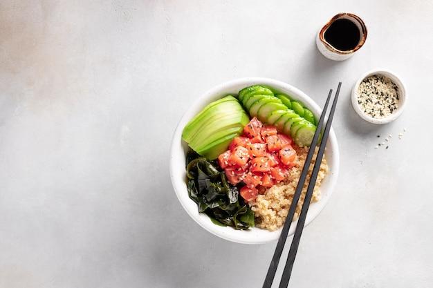 Buddha bowl with salmon, quinoa, wakame seaweed