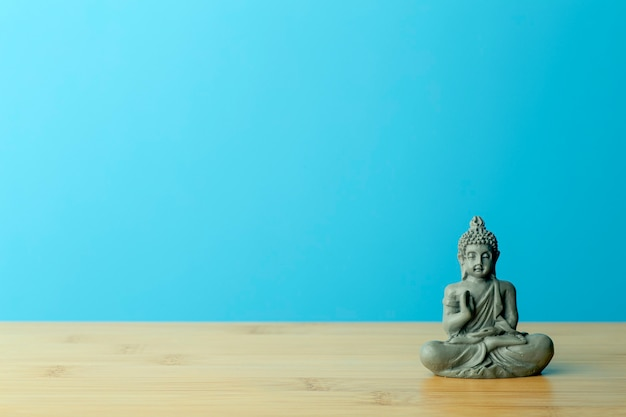 Buddha figurine on table