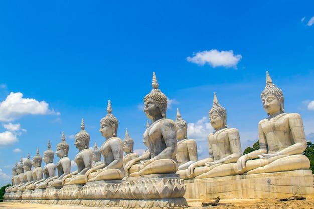 Buddha statue and blue sky, nakhon si thammarat province, thailand.