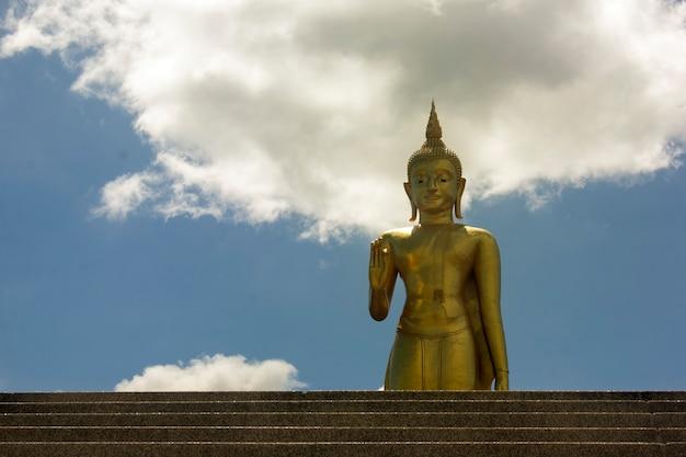 Buddha statue and cloudy sky