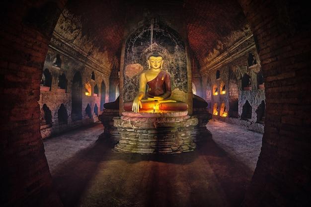 Buddha statue inside old pagoda at bagan, myanmar.