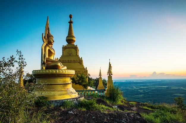 Buddha statue and pagoda on high mountain in phu-lang-ka national park, thailand.