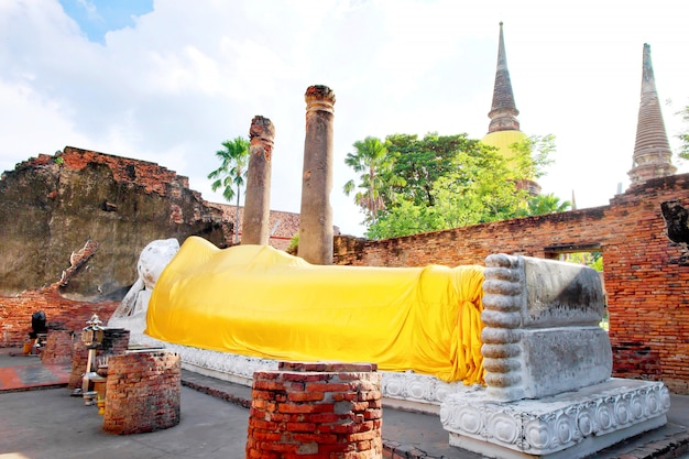 Buddha statue and pagoda with sunlight at wat yai chaimongkol, ayutthaya, thailand