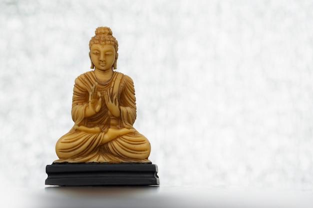 Buddha statue on a soft-light background