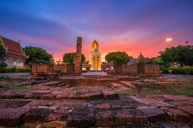 Buddha statue at sunset are buddhist temple at wat phra si rattana mahathat in phitsanulok