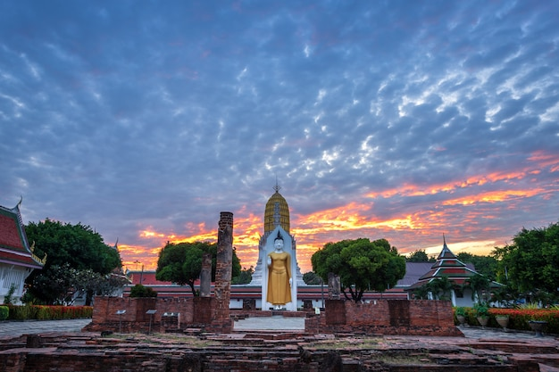 Buddha statue at sunset are buddhist temple at wat phra si rattana mahathat