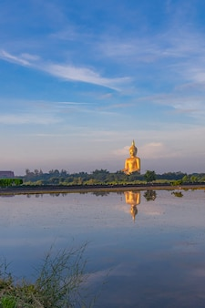 Buddha statue with reflection of wat muang,  ang thong province, thailand