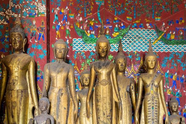 Buddha statues at wat xieng thong in luang prabang, laos.