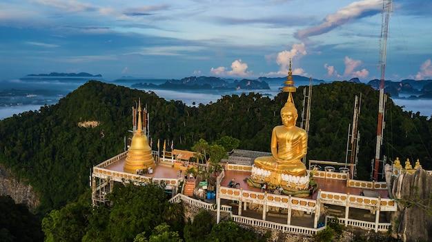 Buddha on the top mountain of wat tham seua (tiger cae) , krabi,thailand