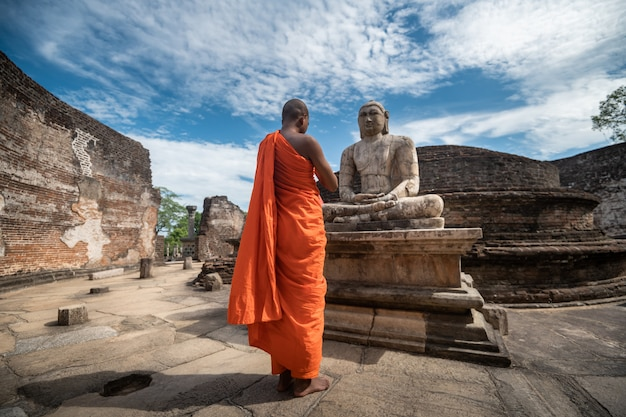 Buddhist monk at historical polonnaruwa vatadage in polonnaruwa, sri lanka