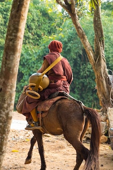 Buddhist monk ride horse at chiangrai .