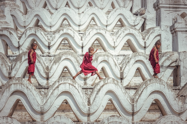 Buddhist novice monk are walking in pagoda, myanmar