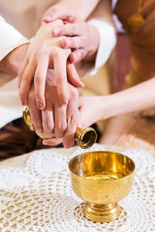 Buddhist's grail pouring water in wedding couple