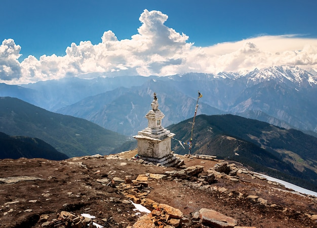 Buddhist stupa on mountain trekking path in himalayas. two days before the earthquake nepal. this stupa was destroyed. langtang national park