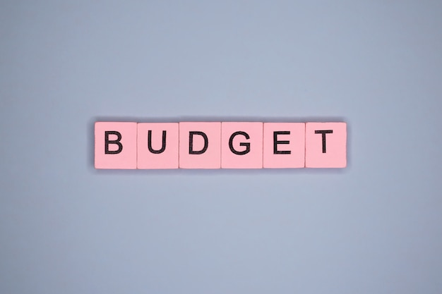 Budget, on blue table
