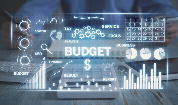 Budget word with arrows and graphs. business