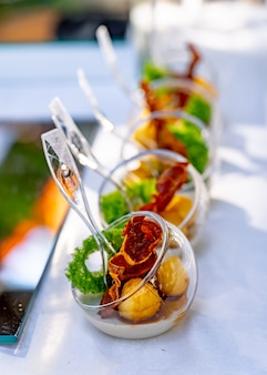 Buffet table with cold appetizers and aperitifs. modern design of ball plates. selective focus. close up.