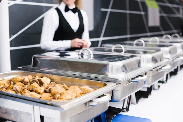 Buffet with chicken served on metal box