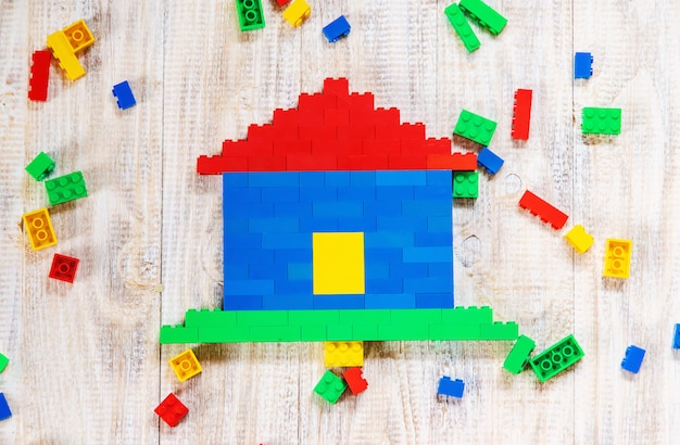 Build a designer lego house. selective background.