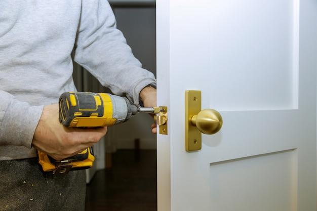 Builder is installing lock a doot in the room