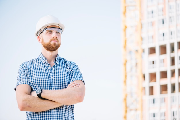Builder posing on site