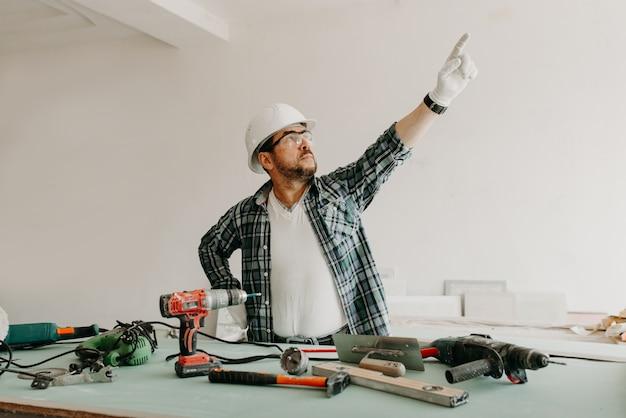 A builder in a safety helmet