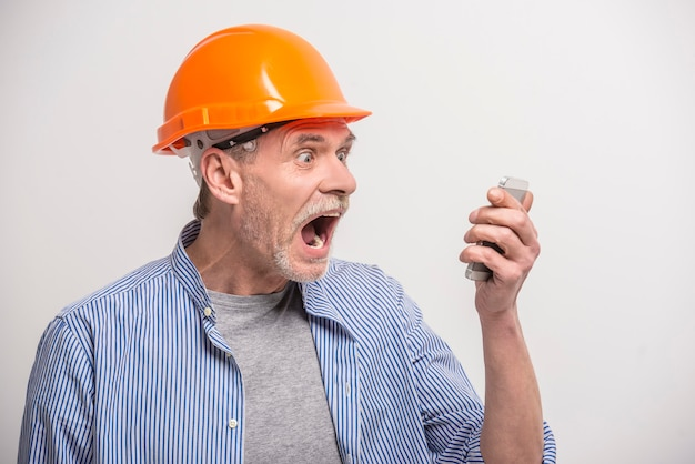Builder talking on phone