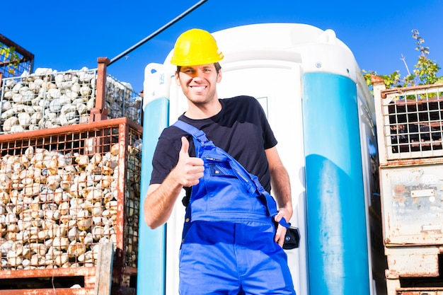 Builder using mobile toilet on site