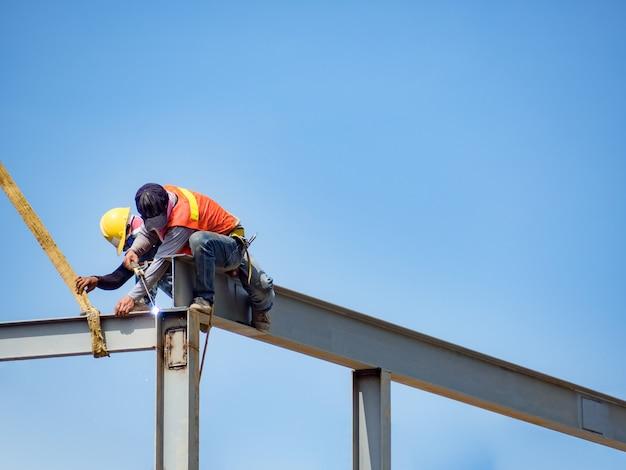 Builder welding on high-rise steel frame
